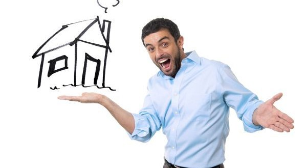 happy attractive man presenting house sketch in new property bu