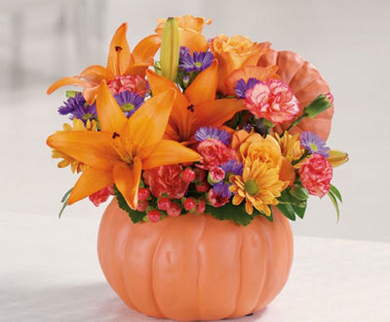 Beautiful floral creation along with some pumpkins