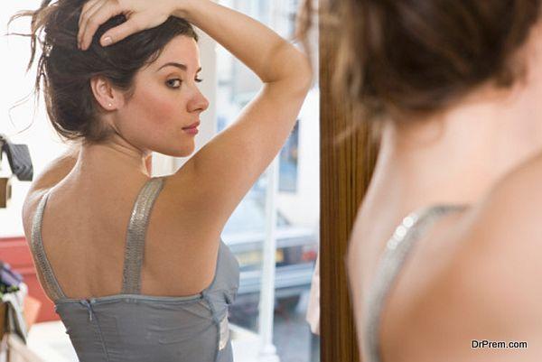 looking into mirror