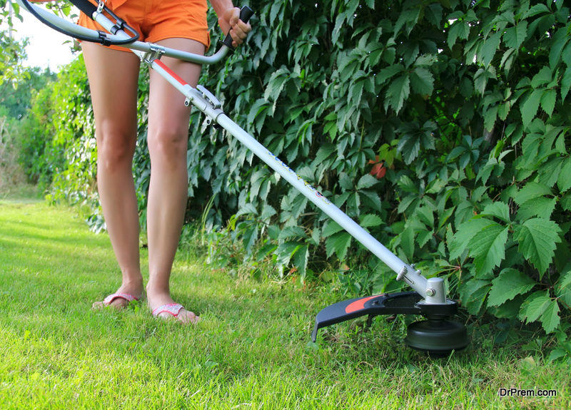 woman maintaining lawn
