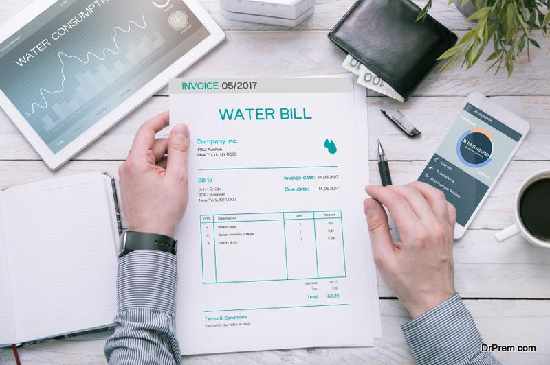 Man holds water bill